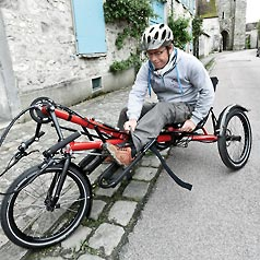 man on hase handcycle